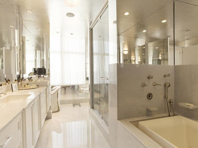 Photo of incredible modern luxury bathroom in New York penthouse