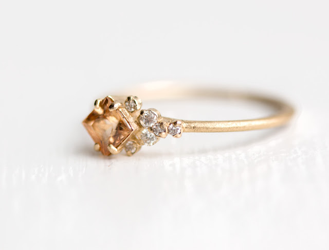 Princess cut peach imperial topaz and diamond cluster ring in 14k gold shown with brushed matte finish.