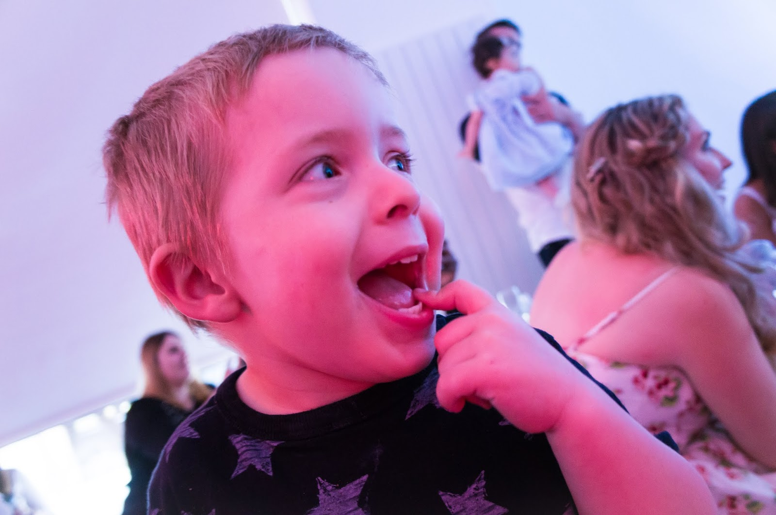 excited little boy watching performances at nuby big reveal event