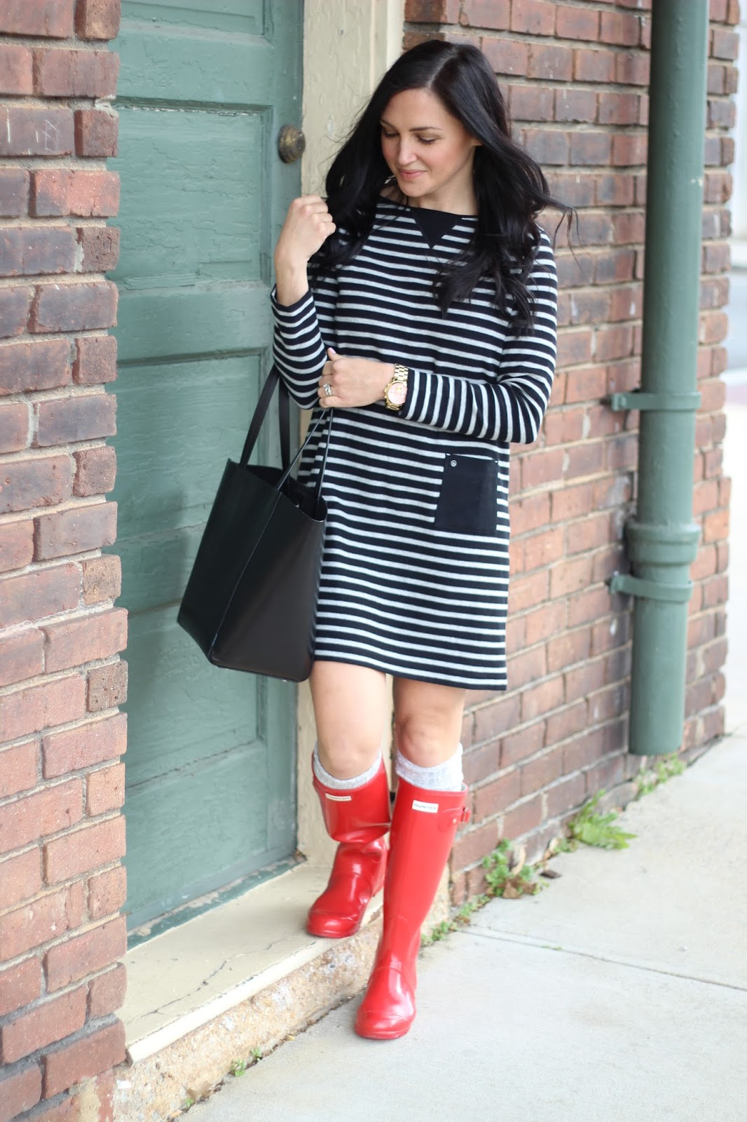 Black and grey stripe dress with red Hunter Boots