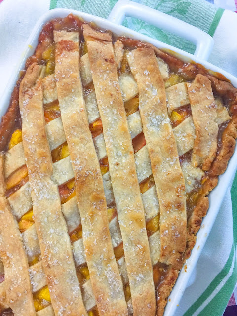 Fresh Peach Cobbler made with a bottom crust and a lattice crust on the top that gives the taste of peach dumplings with every bite!