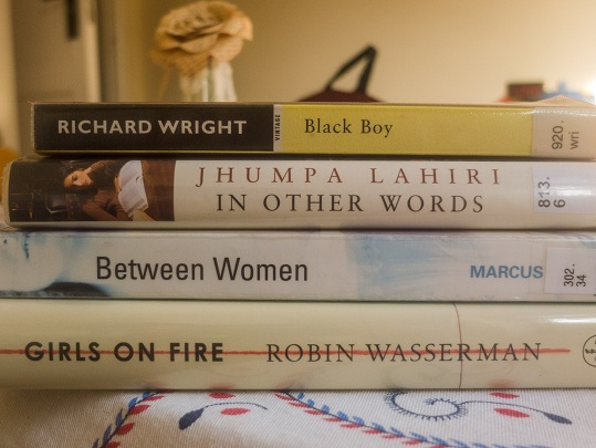 Book pile: Black Boy by Richard Wright, In Other Words by Jhumpa Lahiri, Between Women by Sharon Marcus, Girls on Fire by Robin Wasserman