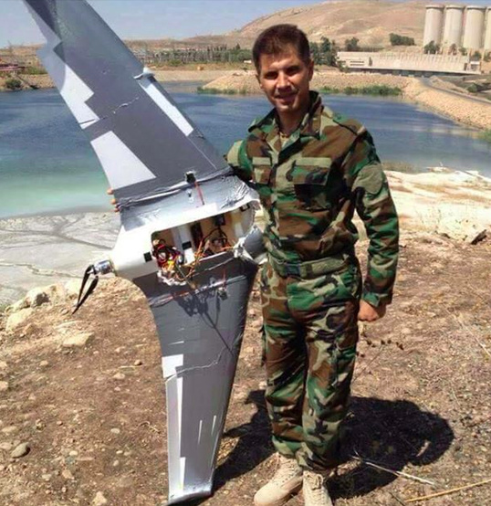 Image Attribute: Peshmerga Soldier with Chinese-built Skywalker X-8 Drone (flown by ISIS) near Mosul Dam, Iraq / October 2016
