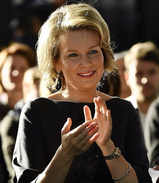 Queen Mathilde wore Natan top and trouser, Gianvito Rossi shoes, New winter collection dress, handbags, boots