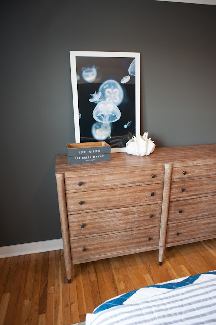 Wood dresser in beachy bedroom