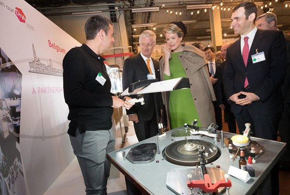 Queen Mathilde wore a wool coat by Natan, and Natan green dress