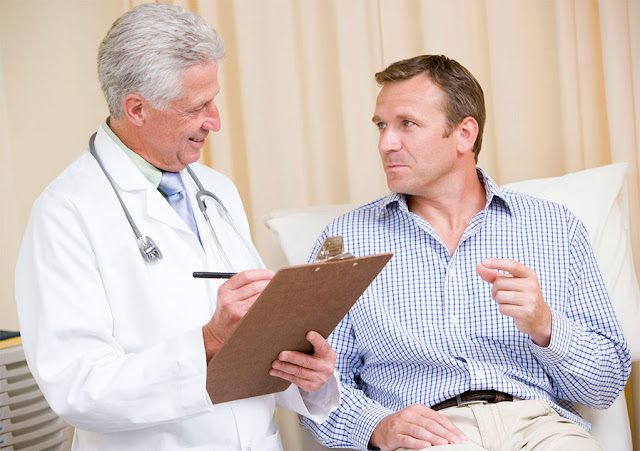 Doctor evaluating patient for treatment of inflammatory bowel disease.