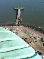 Visitor boat dock damage from Sandy viewed from the Statue of Liberty's crown. (Credit: NPS Sandy Response/flickr) Click to Enlarge.