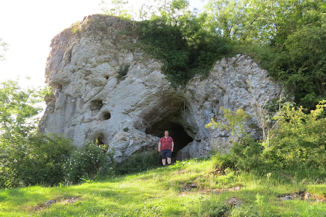 A limestone outcrop with a cave entrance.