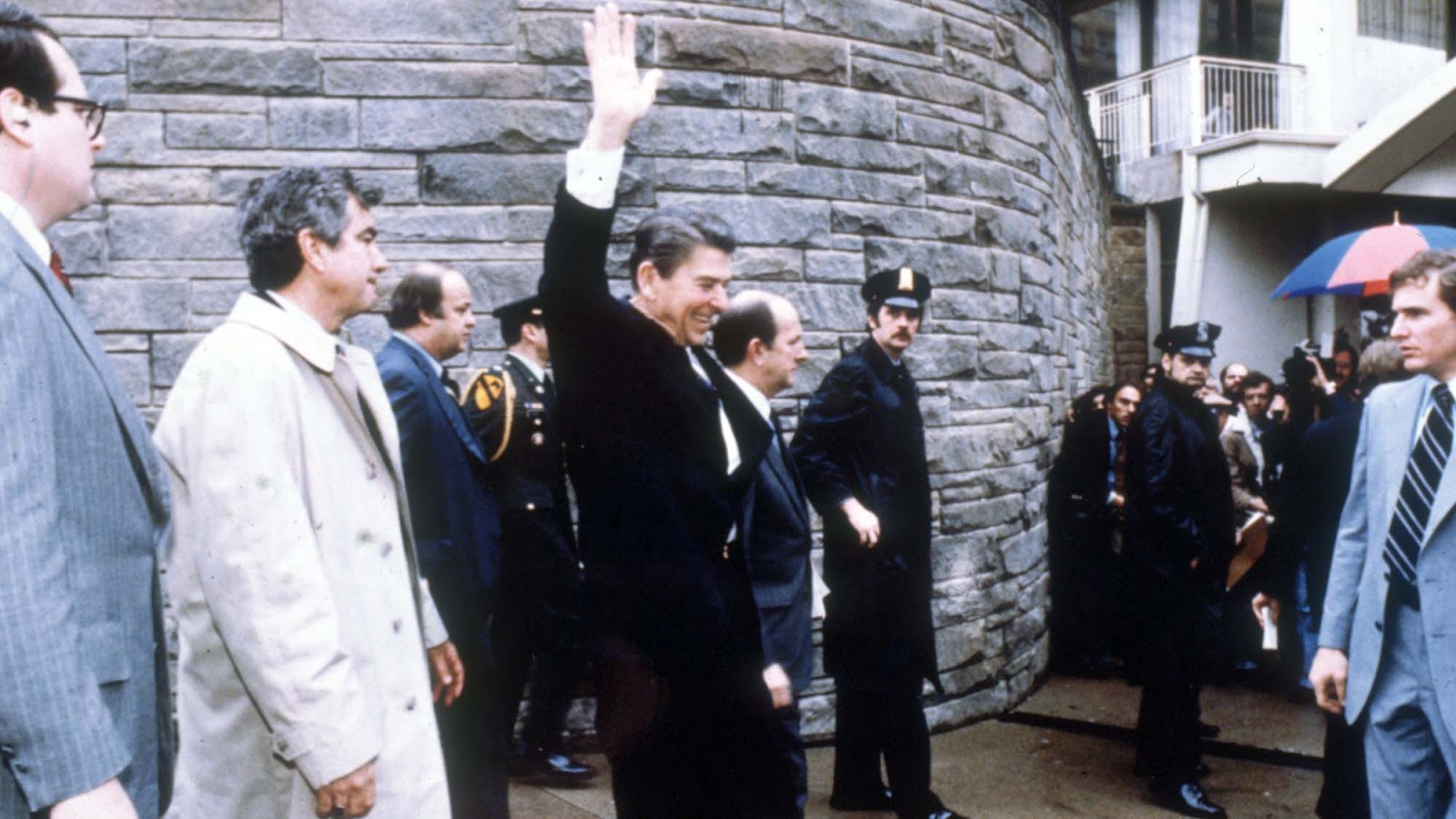 As Reagan exited the hotel toward his waiting limousine, Hinckley waited within the crowd of admirers.