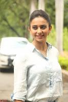 Rakul Preet Singh in Jeans and White Shirt At Jaya Janaki Nayaka le Logo Launch ~  Exclusive 029.JPG