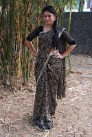 Tamil Actress Sri Priyanka Pos in Saree at Pichuva Kaththi Tamil Movie Audio Launch  0004.JPG