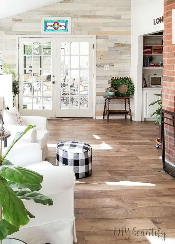 sun room with wood walls and farmhouse laminates