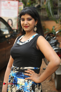 Actress Model Poorni Stills in Floral Long Dress at Silk India Expo Launch  0023.JPG
