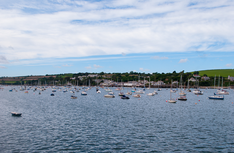 Boats floating along the water of the harbour in falmouth, cornwall, england.
