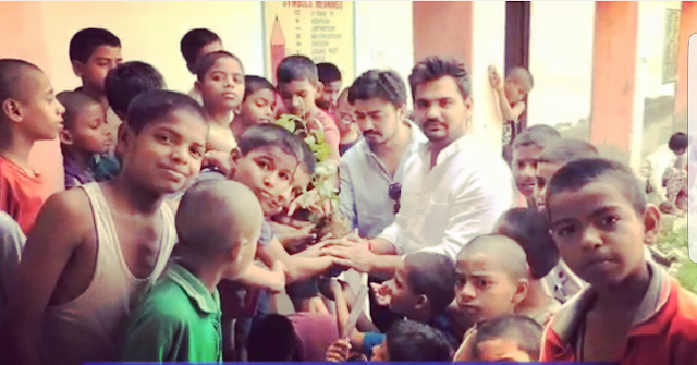 Youth BJP leader Sachin Thakur celebrates birthday with planting children with destitute children