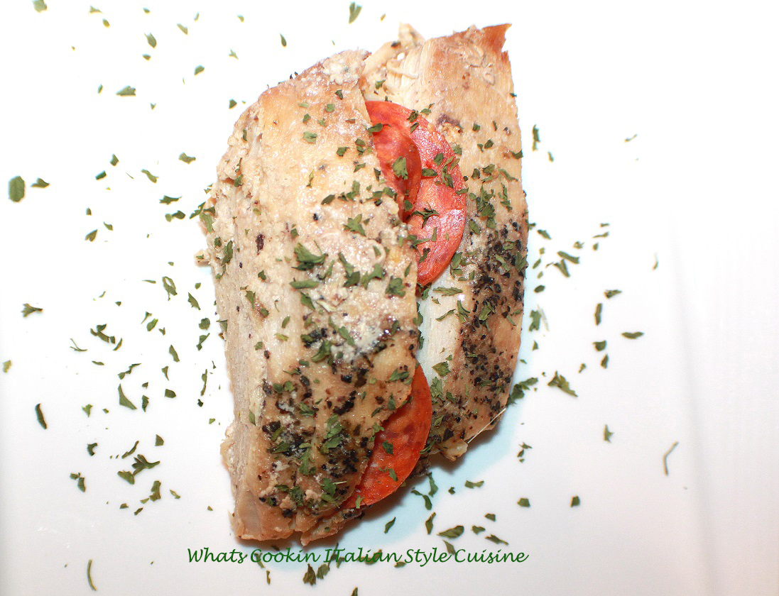 this is a pork tenderloin stuffed with bread crumbs, pepperoni, cheeses, herbs, spices a