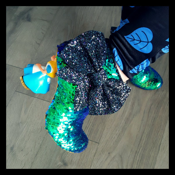 wearing irregular choice alice character heel ankle boot glitter bow detail