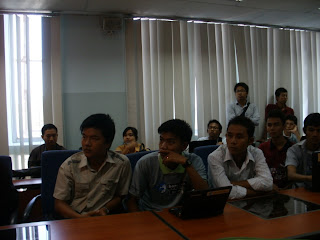 Audience listening to Make FLOSS Software Speak Your Language talk at BarCamp Yangon 2011