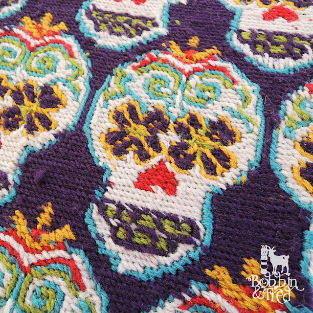 Back of needlepoint tent stitch sugar skulls design
