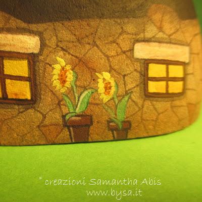 Case dipinte sui sassi girasoli