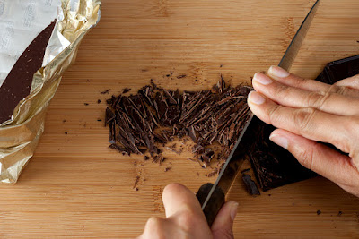Finely chopping chocolate