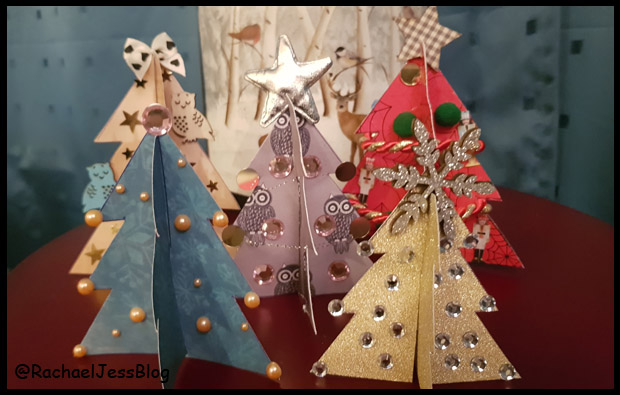 Creating paper christmas trees - perfect craft for kids to make