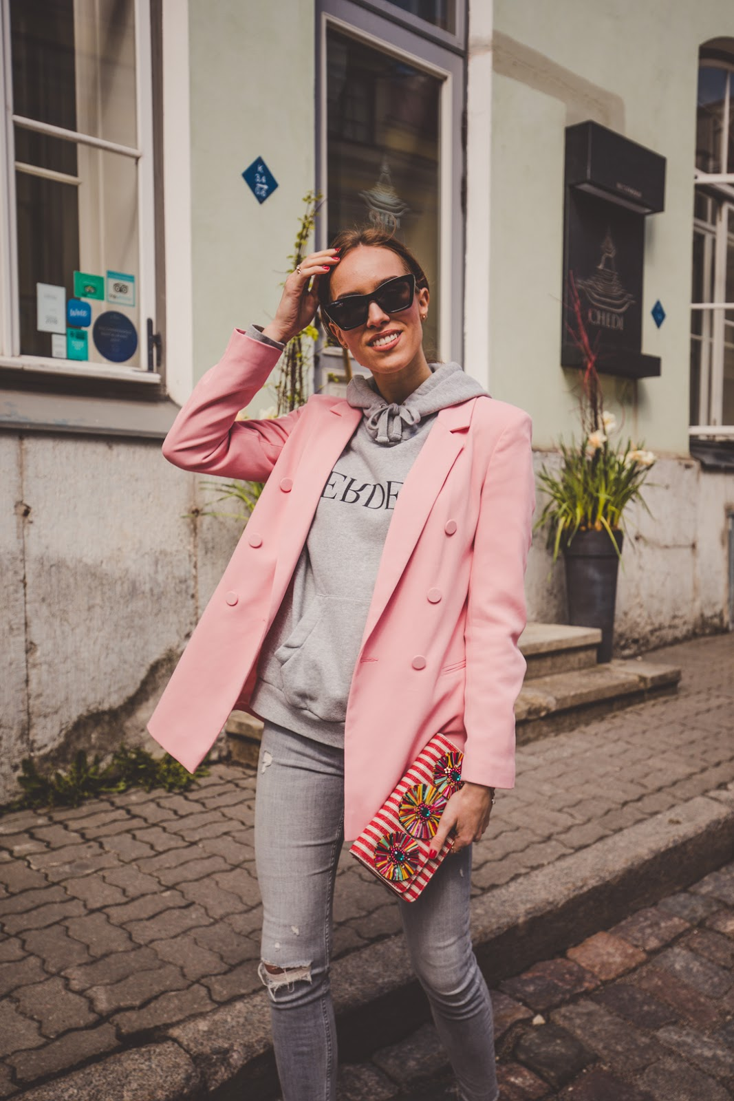 pink blazer grey hoodie outfit