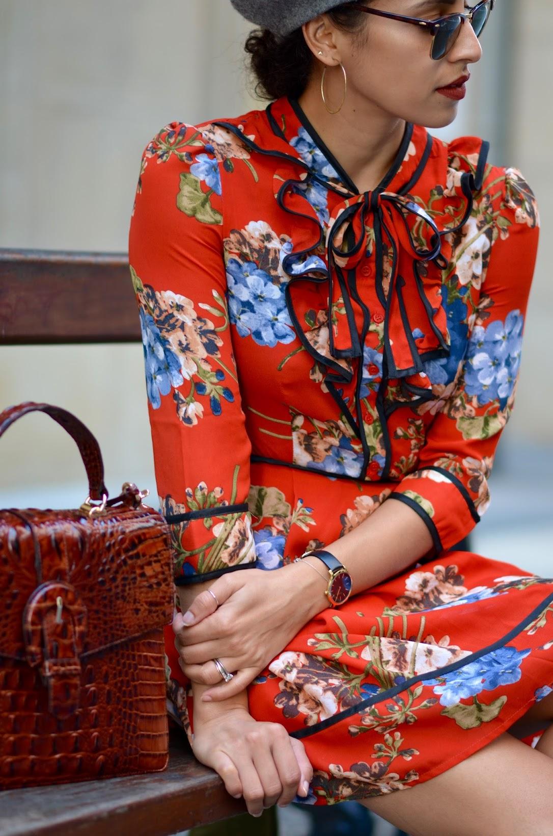 Brahmin leather satchel, grey beret, fall berry lipstick, Colour Pop, hoop earrings, red floral dres, San Sebastian, Spain
