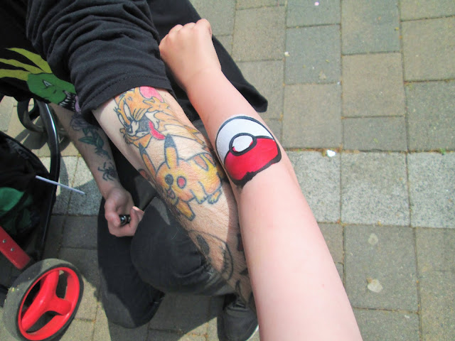Project 365 - Daddies pikachu tattoo beside D's pokeball face paint on his arm