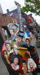 painted guitar of famous country singers