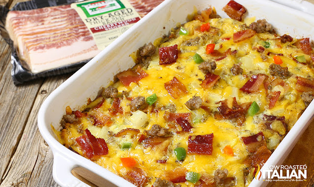 baked eggs with sausage, bacon, cheese, and hash browns in casserole dish