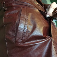 photo of the hidden second outer pocket on the Etienne Aigner leather jacket