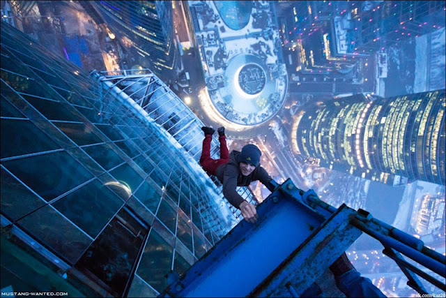 Man hanging from a Russian skyscraper