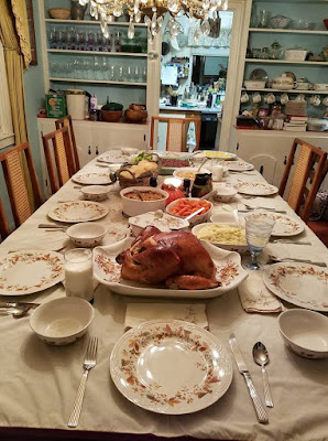 table set for ten with Thanksgiving meal