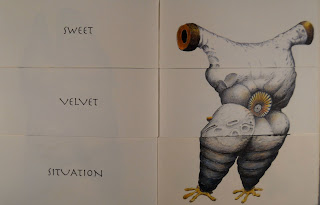 "An open book. The lefthand page shows the text ""Sweet Velvet Situation"" and the right shows a white creature with yellow feet."