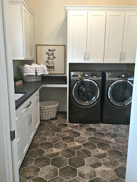 dark hexagon tiled floor in laundry