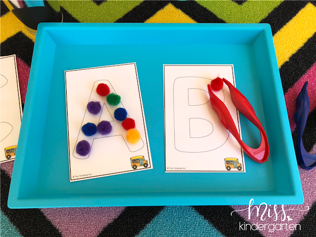 Using tweezers for fine motor practice