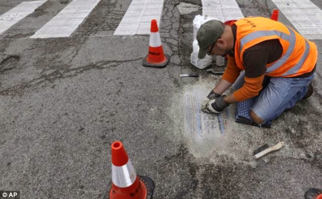 http://www.dailymail.co.uk/news/article-2656250/Talk-street-art-Chicago-artist-fills-citys-potholes-marks-one-beautiful-mosaic.html