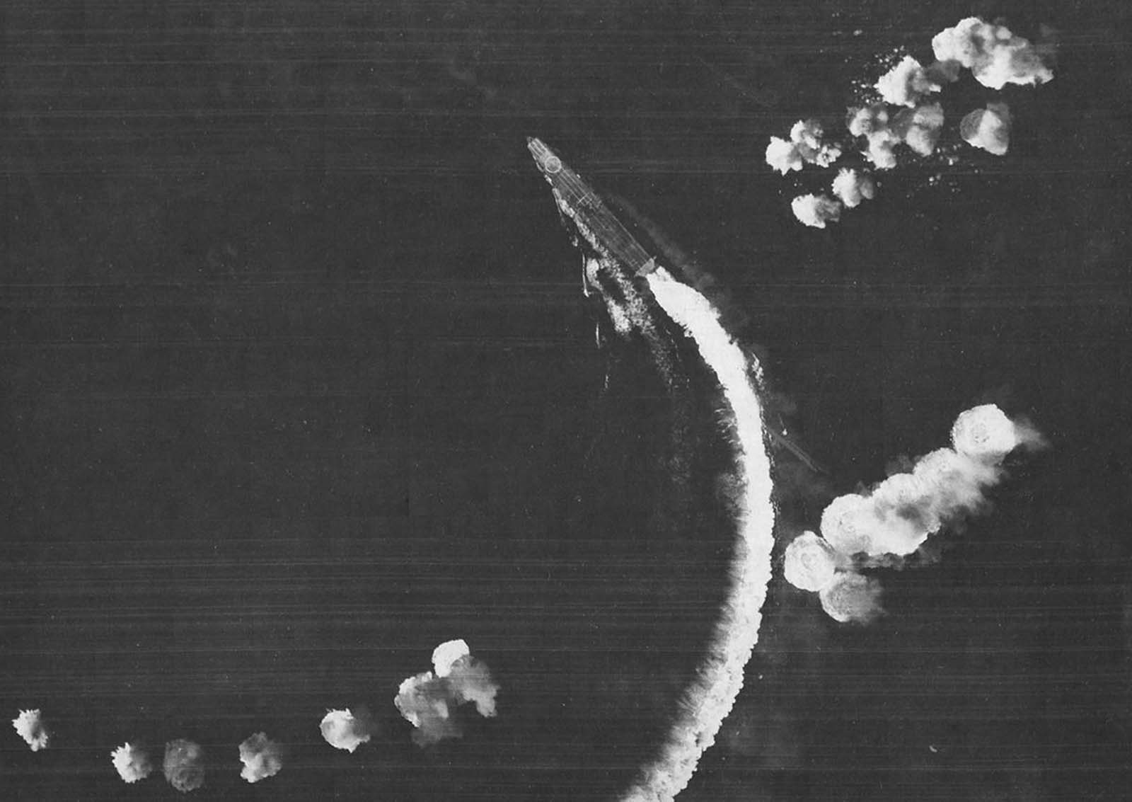 The Japanese carrier Hiryu maneuvers to avoid bombs dropped by Army Air Forces B-17 Flying Fortresses during the Battle of Midway, on June 4, 1942.