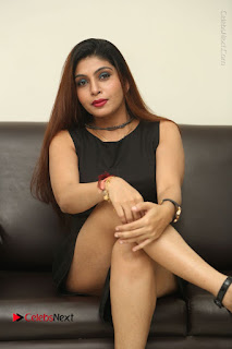 Tollywood Upcoming Actress Pooja Roshan Stills in Black Short Dress at Plus 1 Movie Trailer Launch  0266.JPG