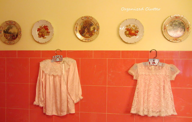 Baby dresses in a vintage bathroom
