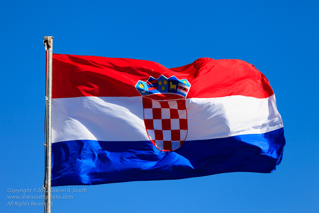 a photo of the croatian flag at sibenik by daniel south