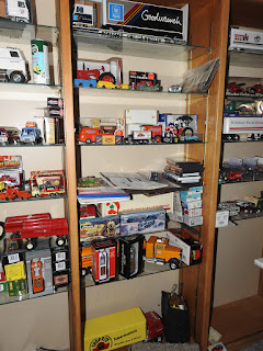 A set of custom made display shelves loaded with collectible die cast toys.