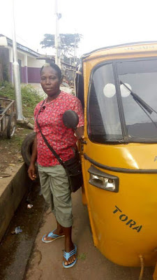 (PHOTOS) Must See: A widow driving Keke Tricycle to take care of her family in Umuahia