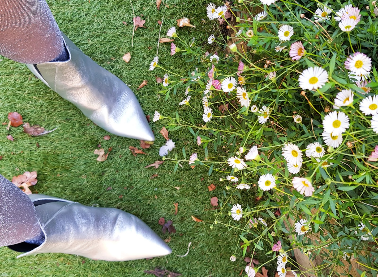 Close up of silver ankle boots with a kitten heel from Office London