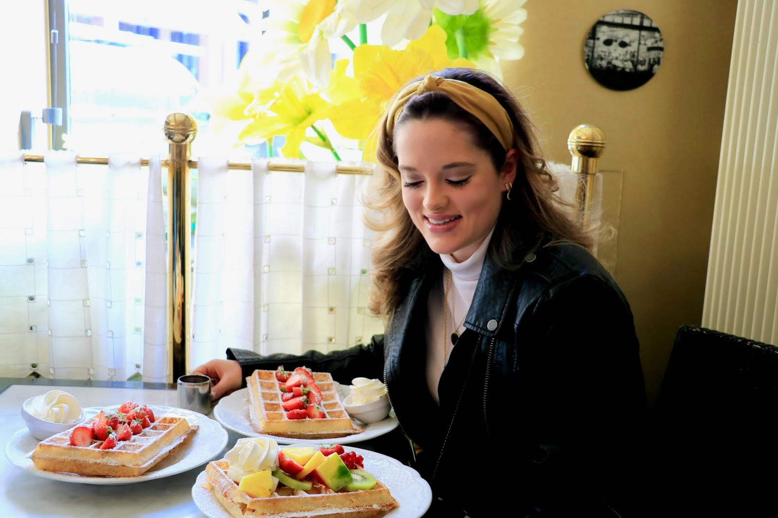 Fashion blogger Kathleen Harper eating waffles at one of the best restaurants in Ghent, Belgium