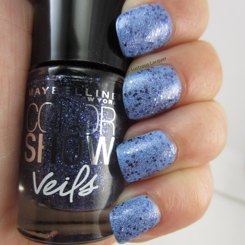 Blue glitter nail polish in a clear base
