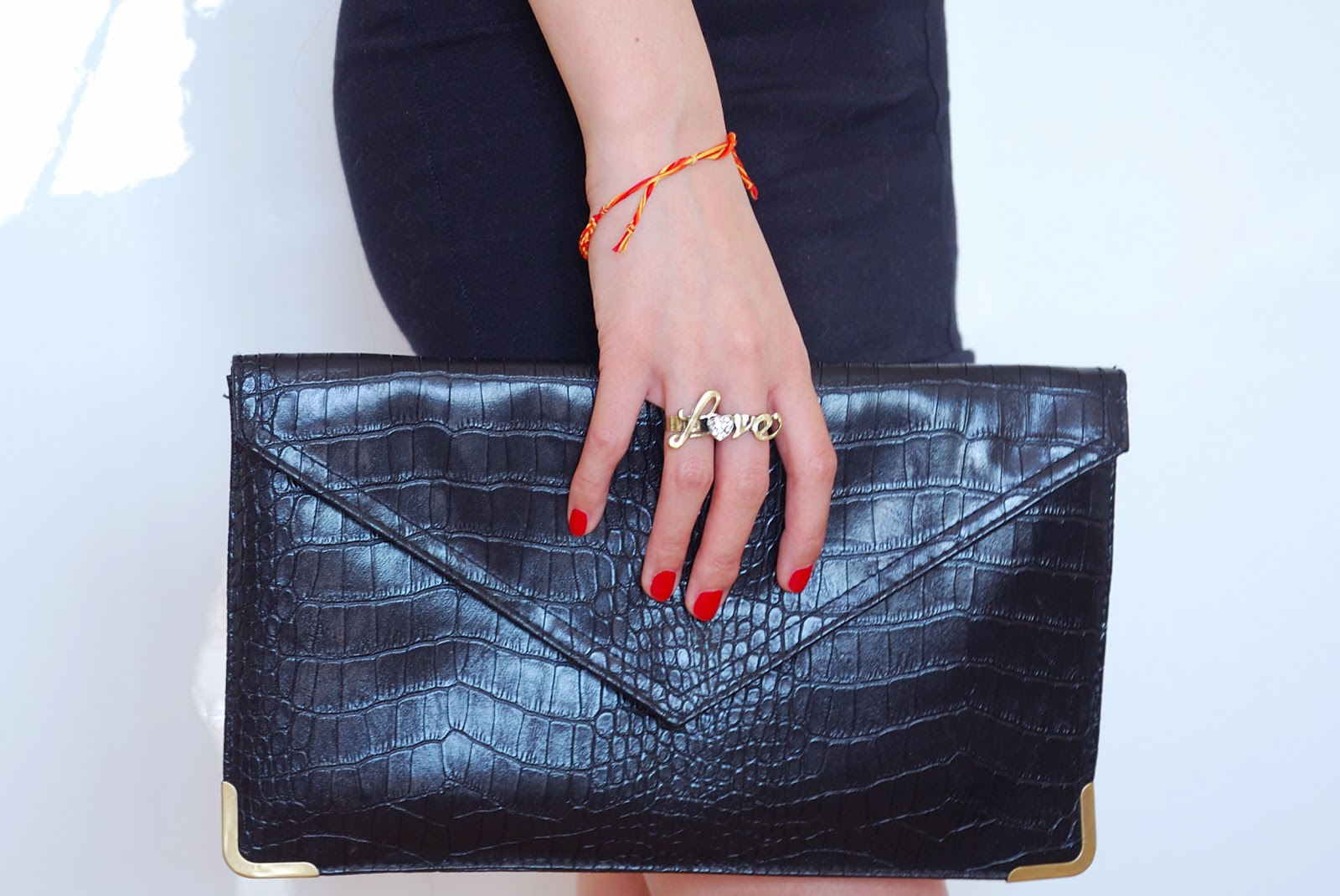 black faux snake skin clutch bag