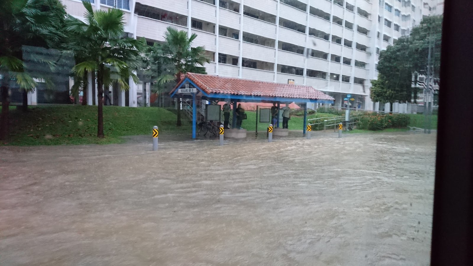 Flash floods seen at Hougang Avenue 8.